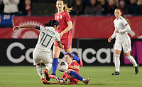 CARSON, CA - FEBRUARY 7: Megan Rapinoe #15 of the United States slide tackles Stephany Mayor #10 of Mexico during a game between Mexico and USWNT at Dignity Health Sports Park on February 7, 2020 in Carson, California.