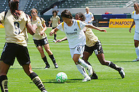 Aya Miyama #8 of the Los Angeles Sol heads a loose ball against the defense of FC Gold Pride during their match at Home Depot Center on April 19, 2009 in Carson, California.