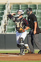 Kannapolis Intimidators catcher Jeremy Dowdy (25) makes a throw to third base following a strike out during the game against the Delmarva Shorebirds at CMC-NorthEast Stadium on July 1, 2014 in Kannapolis, North Carolina.  The Intimidators defeated the Shorebirds 5-2. (Brian Westerholt/Four Seam Images)