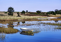 Dinghy anchored in shallow salt pond, Martha's Vineyard, Massachusetts, USA