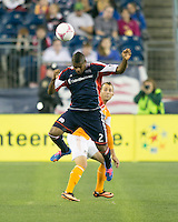 New England Revolution defender Andrew Farrell (2) heads a high ball in front of Houston Dynamo forward Brad Davis (11).  The New England Revolution played to a 1-1 draw against the Houston Dynamo during a Major League Soccer (MLS) match at Gillette Stadium in Foxborough, MA on September 28, 2013.