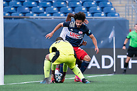 FOXBOROUGH, MA - JUNE 26: Earl Edwards Jr. #90 of the New England Revolution retrieves the ball as Ryan Spaulding #34 of the New England Revolution holds off an attacker during a game between North Texas SC and New England Revolution II at Gillette Stadium on June 26, 2021 in Foxborough, Massachusetts.