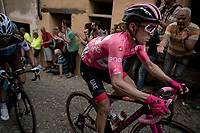 Maglia Rosa / overall leader Valerio Conti (ITA/UAE-Emirates) up the steep, cobbled & crowded climb in Pinerolo<br /> <br /> Stage 12: Cuneo to Pinerolo (158km)<br /> 102nd Giro d'Italia 2019<br /> <br /> ©kramon