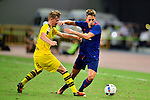 Manchester United winger Adnan Januzaj (r) fights for the ball with Borussia Dortmund Jacob Larsen (l) during the International Champions Cup China 2016, match between Manchester United vs Borussia  Dortmund on 22 July 2016 held at the Shanghai Stadium in Shanghai, China. Photo by Marcio Machado / Power Sport Images