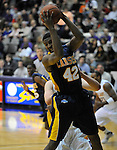 13 December 2008: Tomas Vazquez-Simmons of Canisius  grabs a rebound in a game between Canisius and Albany won by Albany 74-46 at SEFCU Arena in Albany, New York.