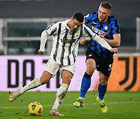 Football Soccer: Tim Cup Semi Finals second leg Juventus vs InternazionaleMilan, Allianz Staium Stadium in Turin, on February 9, 2021.<br /> Juventus Cristiano Ronaldo (r) in action with Inter's Nicolò Barella (l) during the Italian Tim Cup Semi Final match between Juventus vs InterMilan at Allianz Stadium in Turin, on February 9, 2021.<br /> UPDATE IMAGES PRESS/Isabella Bonotto