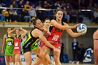 Tactix' Sophia Fenwick takes a pass under pressure from Whitney Souness during the ANZ Premiership netball match between Central Pulse and Mainland Tactix at Te Rauparaha Arena in Wellington, New Zealand on Friday, 9 July 2021. Photo: Dave Lintott / lintottphoto.co.nz