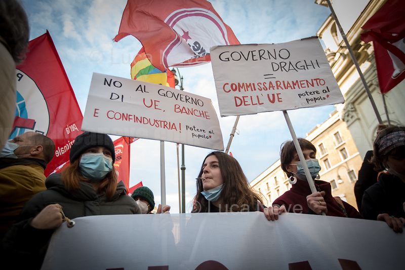 Rome, Italy. 18th Feb 2021. Today, the Trade Union Si Cobas, Potere Al Popolo Party, Rifondazione Comunista Party and other organizations of the non-parliamentarian Left held a rally (1.) in Piazza San Silvestro to protest against the new Italian Government led by the former President of the European Central Bank, BCE, Professor Mario Draghi (2. 3.). From the organisers Facebook event page: «[…] We call to mobilize male and female workers, the unemployed, the precarious, the students, the popular classes and all the associations and people who struggle, who do not want to stand by while a government that is directed expression of a united bosses front is ready to strike us with anti-people policies. It is time to join the fight against the government of banks and bosses: we will not pay for this crisis! […]». The demo ended peacefully, even though there were moments of tension between protesters and full riot gears police officers due to demonstrators aimed to march to the Parliament.<br />