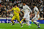 Real Madrid´s Raphael Varane and Villarreal CF´s Gerard Moreno during 2014-15 La Liga match between Real Madrid and Villarreal CF at Santiago Bernabeu stadium in Madrid, Spain. March 01, 2015. (ALTERPHOTOS/Luis Fernandez)