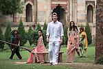 8 October 2013, New Delhi, India. Recently retired Australian cricket star Brett Lee walking through the famous Lodi Gardens in New Delhi with a pair of models and interested locals. He is in India to show off his latest fashion lines and to foster greater interest in Australian - Indian business interactions.  Picture by Graham Crouch
