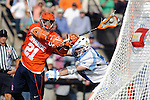 Baltimore, MD - March 17:  Attackmen Tim Desko #21 of the Syracuse Orangemen dives at the cage during the Syracuse v Johns Hopkins mens lacrosse game at  Homewood Field on March 17, 2012 in Baltimore, MD.(Ryan Lasek/Eclipse Sportswire)