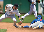 Iowa Cubs' Stephen Perakslis steals safely under the tag of Reno Aces Mike Freeman at Greater Nevada Field in Reno, Nev., on Tuesday, May 17, 2016. The Aces won 5-3. <br />Photo by Cathleen Allison