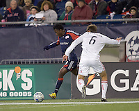 New England Revolution forward/midfielder Kenny Mansally (29) crosses the ball as Chicago Fire defender Brandon Prideaux (6) defends. The New England Revolution tied the Chicago Fire, 0-0, at Gillette Stadium on October 17, 2009.