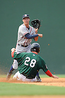 Second baseman Trevor Sprowl (9) of the Rome Braves turns a double play, putting out Sam Travis of the Greenville Drive in a game on Sunday, August 3, 2014, at Fluor Field at the West End in Greenville, South Carolina. Sprowl is a pick of the Atlanta Braves in the 2014 First-Year Player Draft. Rome won, 4-2. (Tom Priddy/Four Seam Images)