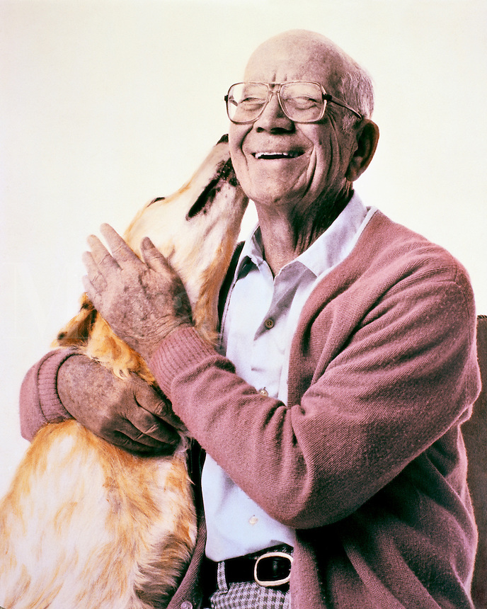 Senior man with pet dog.