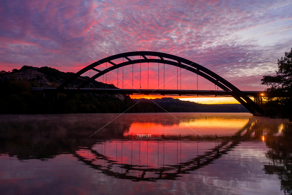 This gorgeous sunrise of the 360 Pennybacker Bridge was taken with my drone hovering just 10 feet above the water as steam rises from Lake Austin. What a spectacular sight this was. Morning photography is among the best times to get spectacular shots when nobody is around and given the peace and quite of nature.