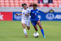 HOUSTON, TX - JANUARY 31: Lixy Rodriguez #12 of Costa Rica fights for the ball with Roseline Eloissaint #11 of Haiti during a game between Haiti and Costa Rica at BBVA Stadium on January 31, 2020 in Houston, Texas.
