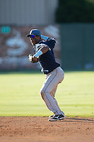 Asheville Tourists second baseman Luis Jean (3) makes a throw to first base against the Kannapolis Intimidators at Intimidators Stadium on June 28, 2015 in Kannapolis, North Carolina.  The Tourists defeated the Intimidators 6-4.  (Brian Westerholt/Four Seam Images)