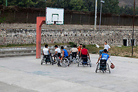 Antigua, Guatemala.  Disabled Young Men in Wheel Chairs Playing Basketball.