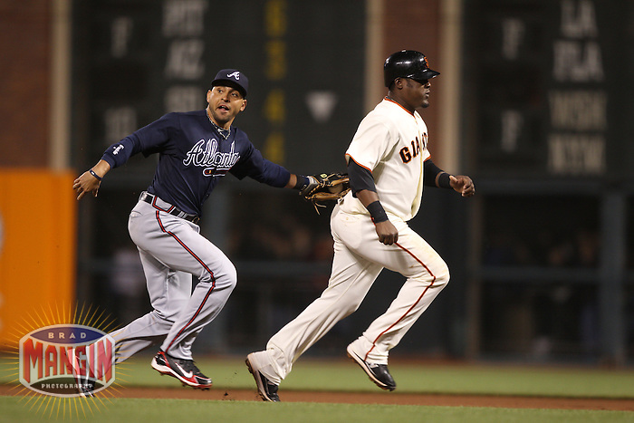 SAN FRANCISCO - APRIL 10:  Omar Infante of the Atlanta Braves makes a play and tags out San Francisco Giants base runner Pablo Sandoval during the game between the Atlanta Braves and the San Francisco Giants on Saturday, April 10, 2010, at AT&T Park in San Francisco, California. The Braves defeated the Giants 7-2.  (Photo by Brad Mangin)