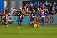 9th October 2021;  VBS Community Stadium, Sutton, London; EFL League 2 football, Sutton United versus Port Vale 9th October 2021; Ricky Korboa (19) of Sutton United is bundled off the ball