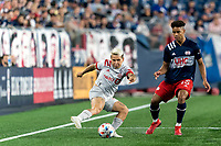 FOXBOROUGH, MA - JULY 7: Yeferson Soteldo #30 of Toronto FC passes the ball as Brando Bye #15 of New England Revolution defends during a game between Toronto FC and New England Revolution at Gillette Stadium on July 7, 2021 in Foxborough, Massachusetts.