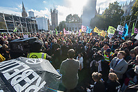 Environmentalists protest about Climate Change at the Extinction Rebellion event in Parliament square. They heard speeches from green campaigners including George Monbiot and Caroline Lucas before blocking the road outside Parliament which led to 15 arrests. London 31-10-18
