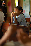 School girl at desk in Midway, a Mayan Village, Southern Belize..