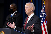 US President Joe Biden (R) delivers remarks to Department of Defense personnel, beside US Secretary of Defense Lloyd Austin (L), at the Pentagon in Arlington, Virginia, USA, 10 February 2021.<br /> CAP/MPI/RS<br /> ©RS/MPI/Capital Pictures