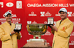 Henrik Stenson and Robert Karlsson of Sweden pose with their Rolex watches next to the trophy after winning the final round of the 54th Omega Mission Hills World Cup of Golf on November 30, 2008 in Shenzhen, China. Photo by Victor Fraile
