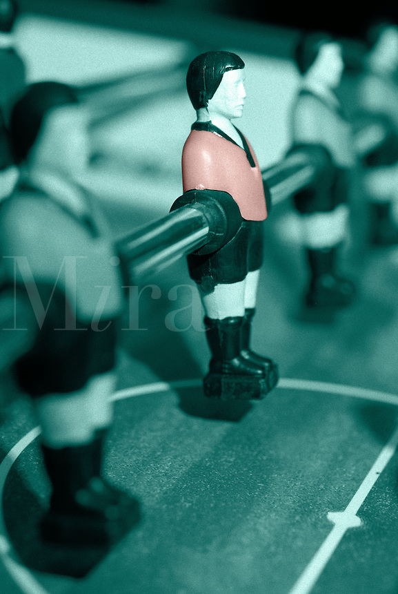 One player in line standing out, Table Soccer game also known as Table Football, close-up