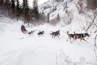 Scottish musher Wattie McDonald manuevers his sled over glare ice of Dalzell Creek in the Dalzell Gorge on the trail to Rohn between Rainy Pass summit and Rohn during the 2010 Iditarod