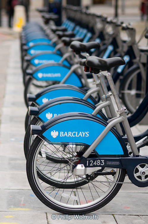 Bikes at a docking station in Waterloo, part of Transport for London's Cycle Hire scheme, funded by Barclays Bank.