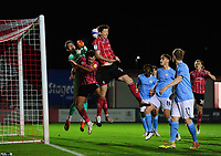 Manchester City U21's Cieran Slicker is fouled by Lincoln City's Tom Hopper, centre, and Lincoln City's Conor McGrandles<br /> <br /> Photographer Chris Vaughan/CameraSport<br /> <br /> EFL Papa John's Trophy - Northern Section - Group E - Lincoln City v Manchester City U21 - Tuesday 17th November 2020 - LNER Stadium - Lincoln<br />  <br /> World Copyright © 2020 CameraSport. All rights reserved. 43 Linden Ave. Countesthorpe. Leicester. England. LE8 5PG - Tel: +44 (0) 116 277 4147 - admin@camerasport.com - www.camerasport.com