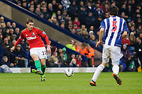 Saturday, 9 March 2013<br /> <br /> Pictured:  Angel Rangel of Swansea City kicks the ball around Claudio Yacob of West Bromwich Albion <br /> <br /> Re: Barclays Premier League West Bromich Albion v Swansea City FC  at the Hawthorns, Birmingham, West Midlands