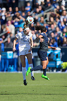 Cary, North Carolina - Sunday December 6, 2015: Kara Wilson (15) of the Duke Blue Devils heads the ball away from Raquel Rodriguez (11) of the Penn State Nittany Lions during first half action at the 2015 NCAA Women's College Cup at WakeMed Soccer Park.  The Nittany Lions defeated the Blue Devils 1-0.