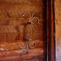 A detail of a rusted door handle