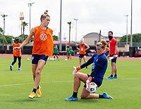HOUSTON, TX - JUNE 12: Kristie Mewis #22 has her shot saved by Alyssa Naeher #1 of the USWNT during a training session at University of Houston on June 12, 2021 in Houston, Texas.