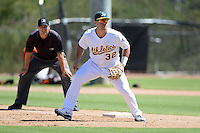 Oakland Athletics first baseman Ryan Huck (32) during an instructional league game against the San Francisco Giants on September 27, 2013 at Papago Park Baseball Complex in Phoenix, Arizona.  (Mike Janes/Four Seam Images)