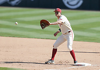 Arkansas infielder Brady Slavens (17) makes a catch, Saturday, April 3, 2021 during the eighth inning of a baseball game at Baum-Walker Stadium in Fayetteville. Check out nwaonline.com/210404Daily/ for today's photo gallery. <br /> (NWA Democrat-Gazette/Charlie Kaijo)