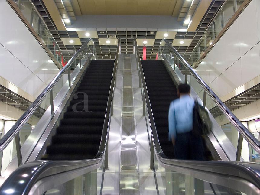 January, 2004 Subway escalators in Singapore public transit system..