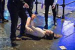 """© Joel Goodman - 07973 332324 . 17/12/2016 . Manchester , UK . A woman slips on the pavement and several men step forward to help her up . Revellers out in Manchester City Centre overnight during """" Mad Friday """" , named for being one of the busiest nights of the year for the emergency services in the UK . Photo credit : Joel Goodman"""