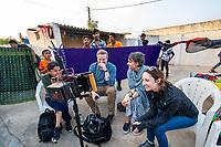 India, Gujarat, Kutch Desert, Bhadroi Village. Checking the monitors.