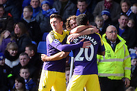Pictured: Jonathan de Guzman of Swansea (R) with team mates Pablo Hernandez and Jose Canas celebrating his equaliser making the score 1-1. Sunday 16 February 2014<br /> Re: FA Cup, Everton v Swansea City FC at Goodison Park, Liverpool, UK.