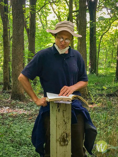 Tolston Wild reading poem in University of Kentucky Arboretum forest.