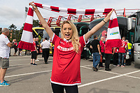 Forest fan Leah Wheeler shows off her new scarf before boarding the bus to Bristol