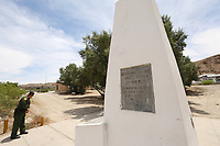 Sunland Park, NM - NEWS:   Ride along with Customs and Border Protection agents, Sunland Park, NM, Monday, April 29, 2019.<br /> <br /> <br /> PICTURED:  The 1st of 276 monuments installed to the West along the land boundary between Mexico and the United States.  The monuments were originally placed in 1855 in accordance with the 1853 treaty and restored in 1989.  Photograph taken from the USA side.  Customs and Border Patrol agent Edward Butron, 35, peeks over towards the Mexican side.<br /> <br /> (Angel Chevrestt, 646.314.3206)