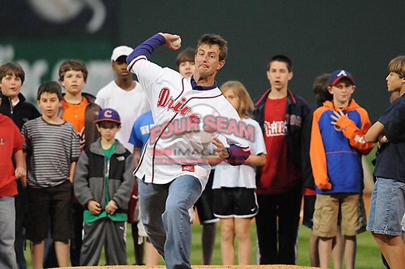 """April 13, 2009: Clemson head football coach Dabo Swinney throws out the ceremonial first pitch before Monday night's 2009 Greenville Drive opening game. Swinney, who was to throw out the first pitch, said Clemson football player C.J. Spiller had just sent him a text message, imploring him """"Don't pull your hamstring"""" when throwing the ball. Photo by: Tom Priddy/Four Seam Images"""