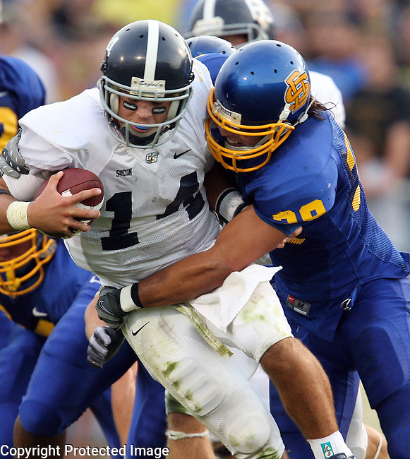 BROOKINGS, SD - SEPTEMBER 12: Derek Domino #39 of South Dakota State University wraps up quarterback Lee Chapple #14 of Georgia Southern for a sack in the second quarter of their game Saturday evening at Coughlin Alumni Stadium in Brookings. (Photo by Dave Eggen/Inertia)