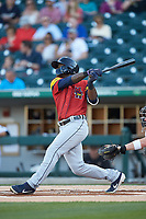 Daz Cameron (10) of the Toledo Mud Hens follows through on his swing against the Charlotte Knights at BB&T BallPark on April 23, 2019 in Charlotte, North Carolina. The Knights defeated the Mud Hens 11-9 in 10 innings. (Brian Westerholt/Four Seam Images)